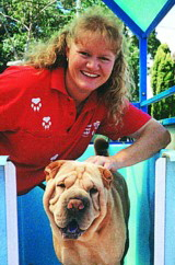 Aussie Pooch Mobile dog wash franchisee Debra Ross hydrobathing a friendly dog in her mobile hydrobath unit.